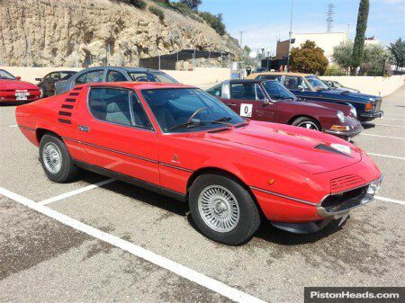 Photo of a red Alfa Romeo Montreal