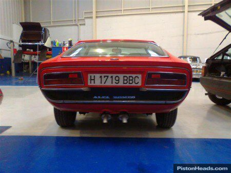 Photo of a Alfa Romeo Montreal from behind.