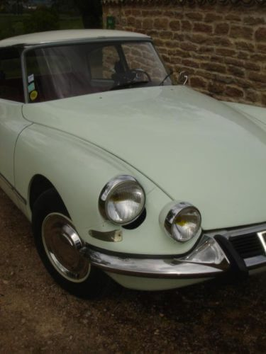 1967 Citroen DS21 in white, close up of headlights.