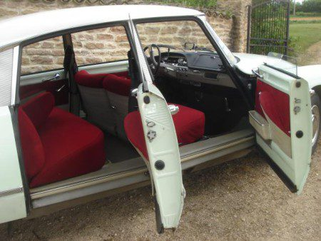 1967 Citroen DS21 with driver and passengers doors open.
