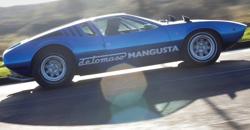 Side shot of a De Tomaso Mangusta driving