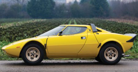 Side view of a yellow Lancia Stratos HF Stradale
