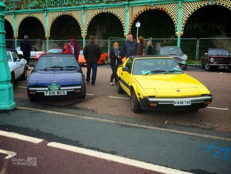 Blue and yellow Bertone x1/9s at the London to Brighton Classic Car Run