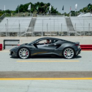 Jensen Button drives the new Lotus Emira at Laguna Seca